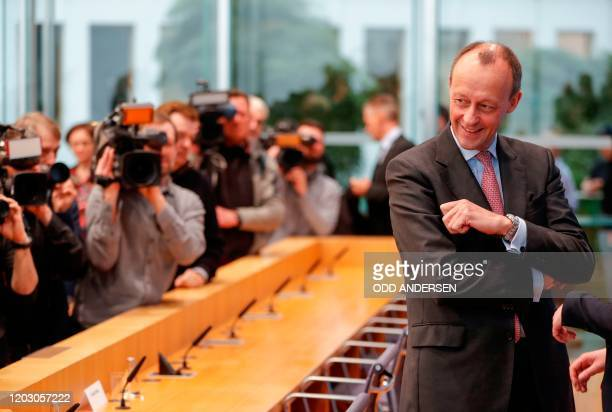 Corporate lawyer and former CDU parliamentary group leader Friedrich Merz faces media as he arrives to address a press conference on February 25 2020...