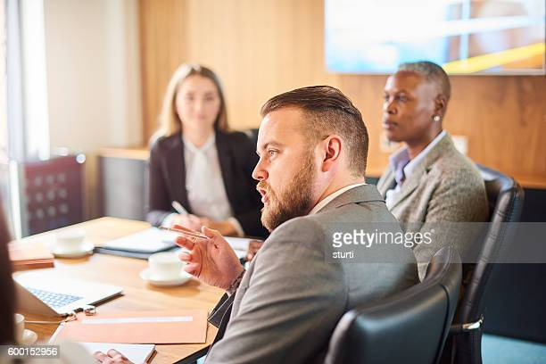 corporate meeting discussions - employment law stock photos and pictures