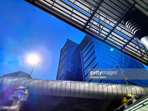 corporate office buildings, highway overpass with sun and lens flare - darling harbour stock pictures, royalty-free photos & images