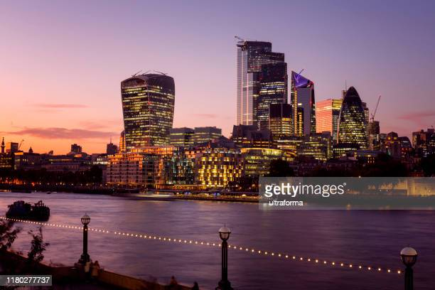 corporate office buildings of city of london at dusk - central london stock pictures, royalty-free photos & images