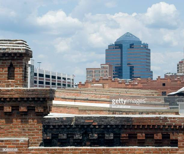 corporate office juxtaposed with brick buildings - urban renewal stock pictures, royalty-free photos & images