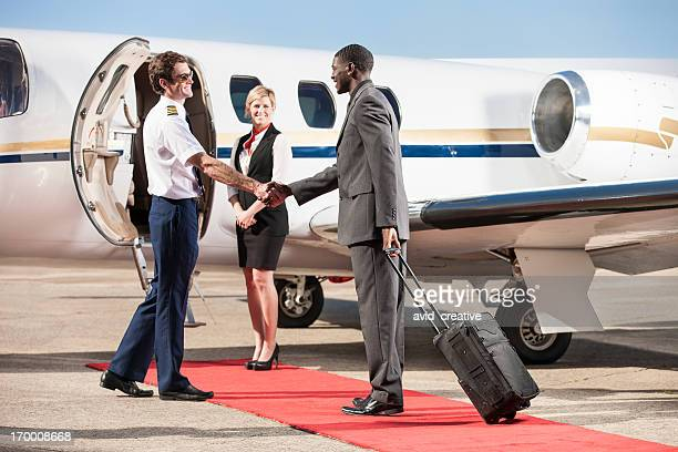 Corporate Pilot Greeting Business Passenger