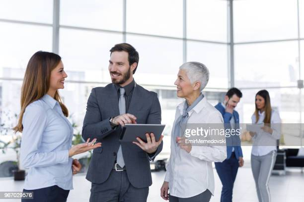 Corporate professional having a stand up meeting