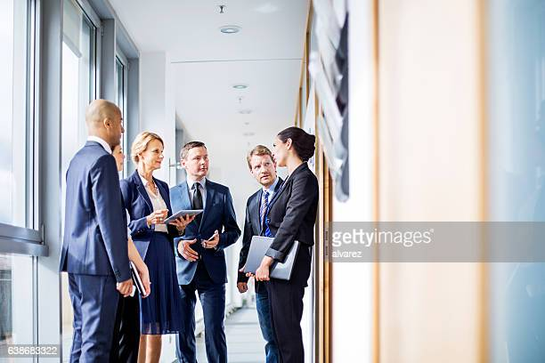 Corporate professional having a standing meeting