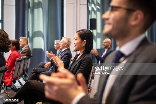 corporate professionals applauding during seminar - entertainment event stock pictures, royalty-free photos & images