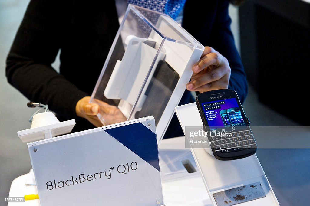 Corporate store manager Diane Baxter prepares a BlackBerry Q10 for display at a Bell Canada retail location in Toronto, Canada, on Tuesday, April 30, 2013. BlackBerry, the Canadian smartphone maker, climbed to its highest level in more than a month after Chief Executive Officer Thorsten Heins said he sees sales of its new Q10 device to be in the 'tens of millions.' Photographer: Galit Rodan/Bloomberg via Getty Images
