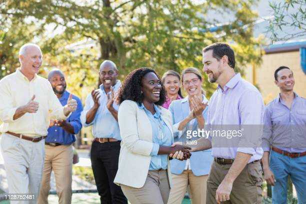 corporate team building, shaking hands - work party stock pictures, royalty-free photos & images