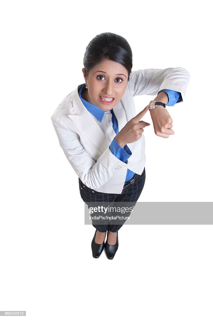 Corporate WOMEN pointing to her watch : Stock Photo