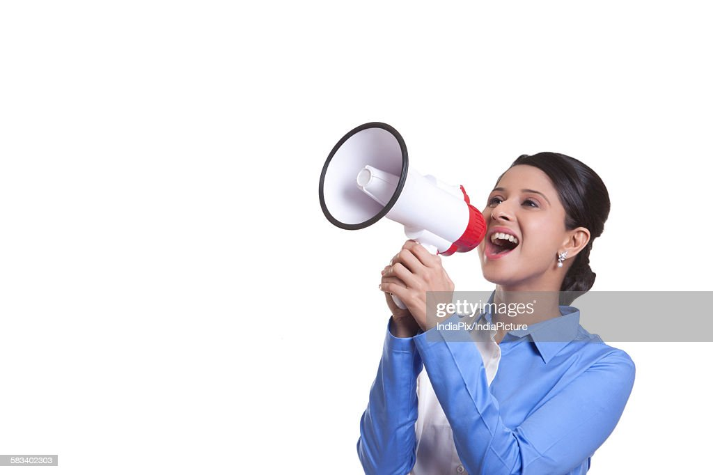 Corporate WOMEN screaming into a megaphone : Stock Photo