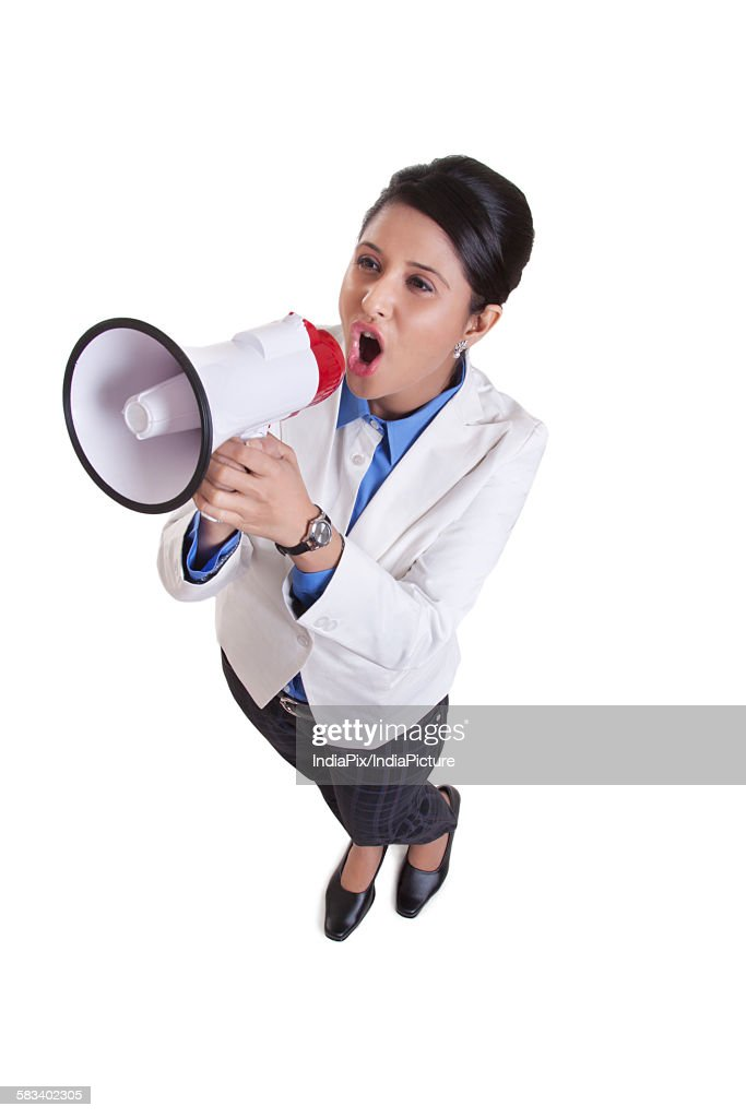 Corporate WOMEN screaming into a megaphone : Stock Photo