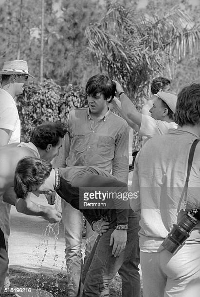A Corporation at Work Nassau Preparing for a scene in their second movie George Harrison gets sprinkled with water while the other member of the...