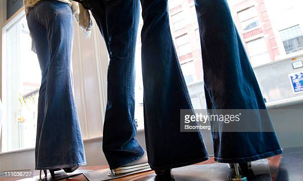VF Corp's 7 for All Mankind bell bottom jeans are displayed on mannequins at a store in New York US on Thursday March 24 2011 With the novelty of...