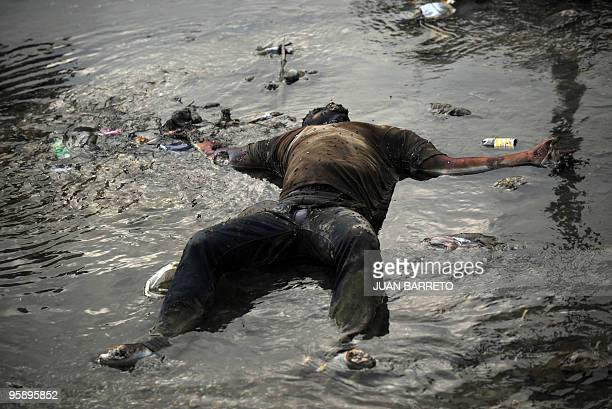 A corpse floats on the surface of a river in PortauPrince January 20 2010 The United States is sending an extra 4000 US troops to quakedevastated...