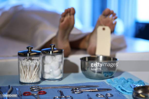 corpse in morgue. focus on toe tag. - autopsy stock pictures, royalty-free photos & images