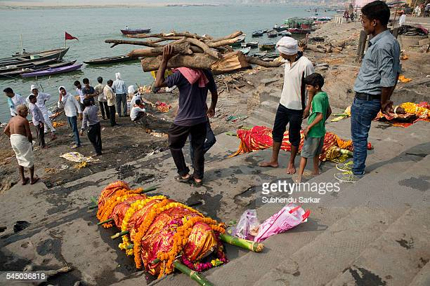 A corpse is lying to be cremated at Manikarnika ghat in Varanasi It is a traditional holy place on the banks of river Ganges to cremate dead bodies...