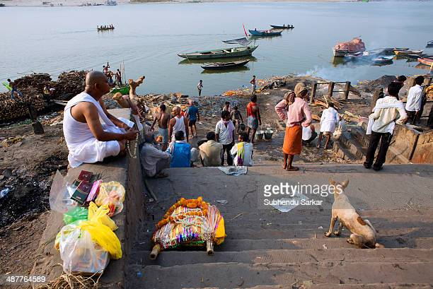 Corpse lie on the steps of Manikarnika cremation ghat in Varanasi Varanasi is a holy city on the banks of the Ganges