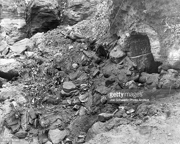 A corpse lies by a Japanese cave siezed by U S Marines during the Battle of Iwo Jima 1945