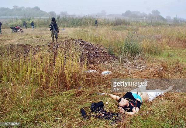 A corpse lies on the ground after a shootout with soldiers on October 28 2011 in Patzcuaro Michoacan state Mexico At least fifteen suspected...