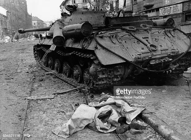 A corpse next to a Soviet tank damaged during the revolt of the Hungarian people Budapest 21st November 1956