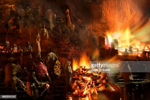 Corpses are being cremated at night at Manikarnika ghat on the banks of River Ganges the most sacred river of Hindus on October 23 2005 at Varanasi...