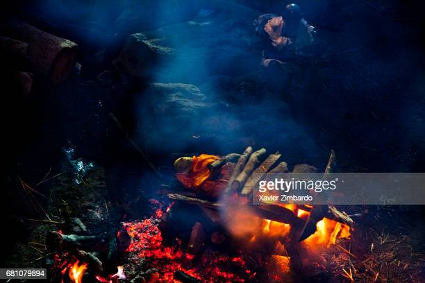 Corpses are being cremated at night at Manikarnika ghat on the banks of Ganges the most sacred river of Hindus on October 27 2005 at Varanasi Uttar...