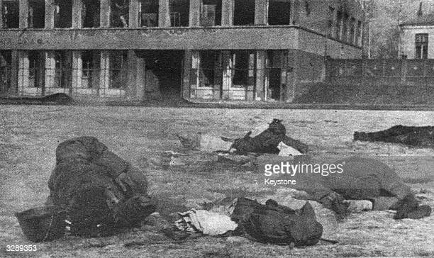 Corpses litter the streets after the Nazis recaptured Kharkov the biggest industrial city in the East Ukraine Inhabitants of the town defended their...