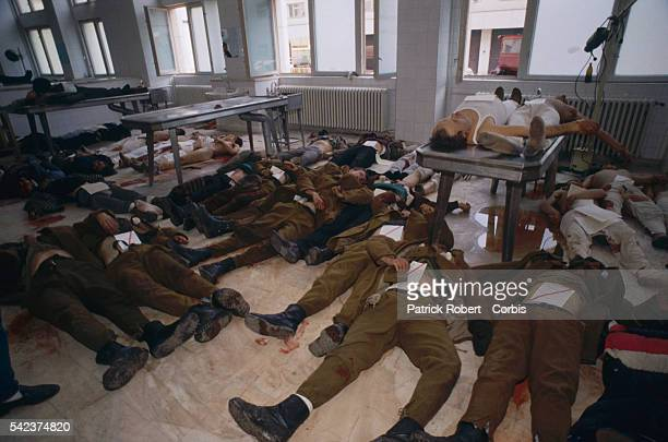 Corpses of riot victims both soldiers and civilians lying on the floor of the Forensic Institute in Bucharest which served as a morgue during the...