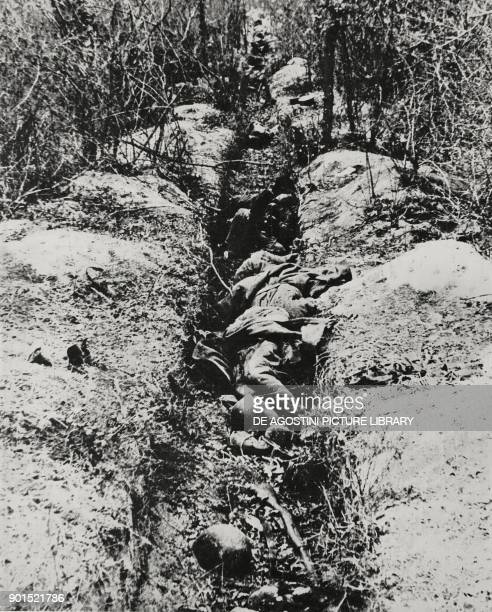 Corpses of Russian soldiers in a trench, Russia, World War II, from L'Illustrazione Italiana, Year LXIX, No 9, March 1, 1942.