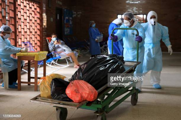 Corpses of victims of COVID-19 are taken towards the mortuary refrigerator at Felipe Arriola Iglesias hospital on May 04, 2020 in Iquitos, Peru....