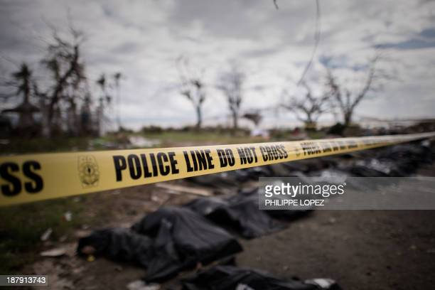 Corpses of victims of Super Typhoon Haiyan are lined up in Tacloban, on the eastern island of Leyte on November 14, 2013. Putrefying corpses in the...