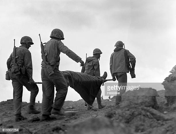 Corpsmen carry a wounded Marine needing medical treatment away from the front lines on Iwo Jima in March 1945 By the end of March the island was in...