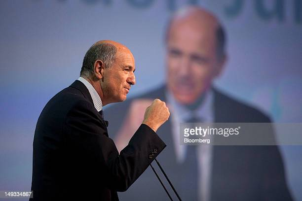 Corrado Passera Italy's economic development minister clenches his fist during a speech at the 'Global Games Global Issues Global Solutions Casa...