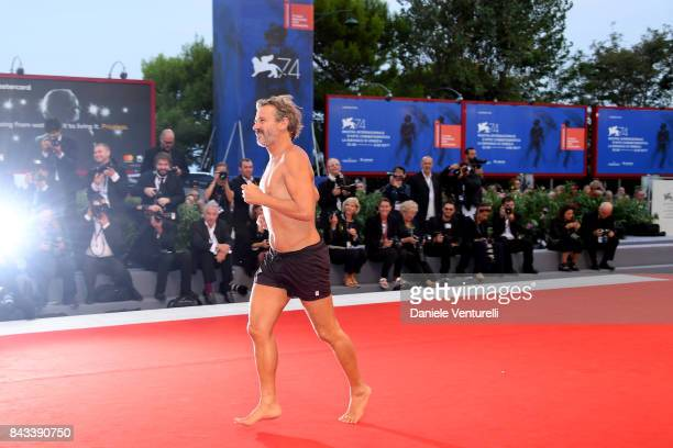 Corrado Sassi walks the red carpet ahead of the 'Ammore E Malavita' screening during the 74th Venice Film Festival at Sala Grande on September 6 2017...
