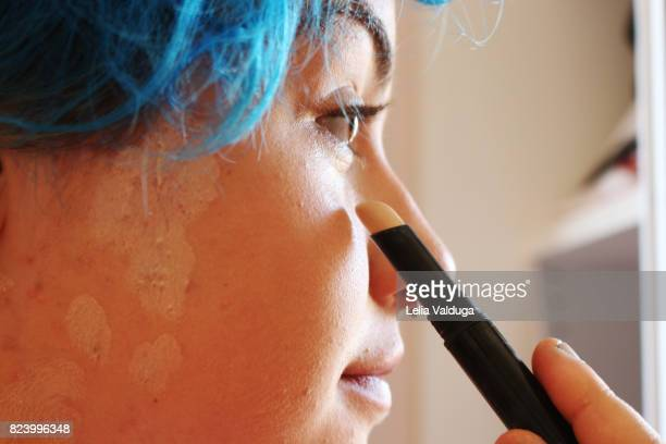 correcting skin imperfections. - correction fluid stock pictures, royalty-free photos & images