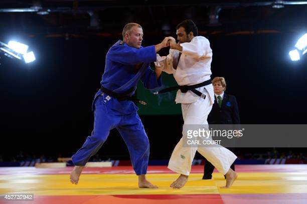 **Correction NB Editor's this is Bronze medal match not Gold** New Zealand's bronze medalist Tim Slyfield fights India's Sahil Pathania in the men's...