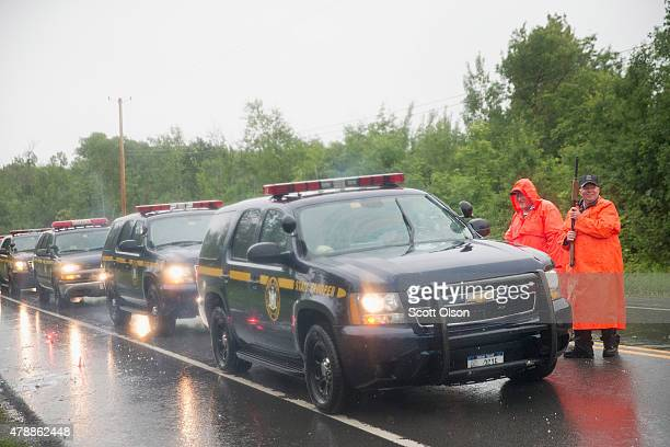Correction officers man a roadblock along Highway 30 near a wooded area where they believe escaped convict David Sweat may be hiding on June 28, 2015...