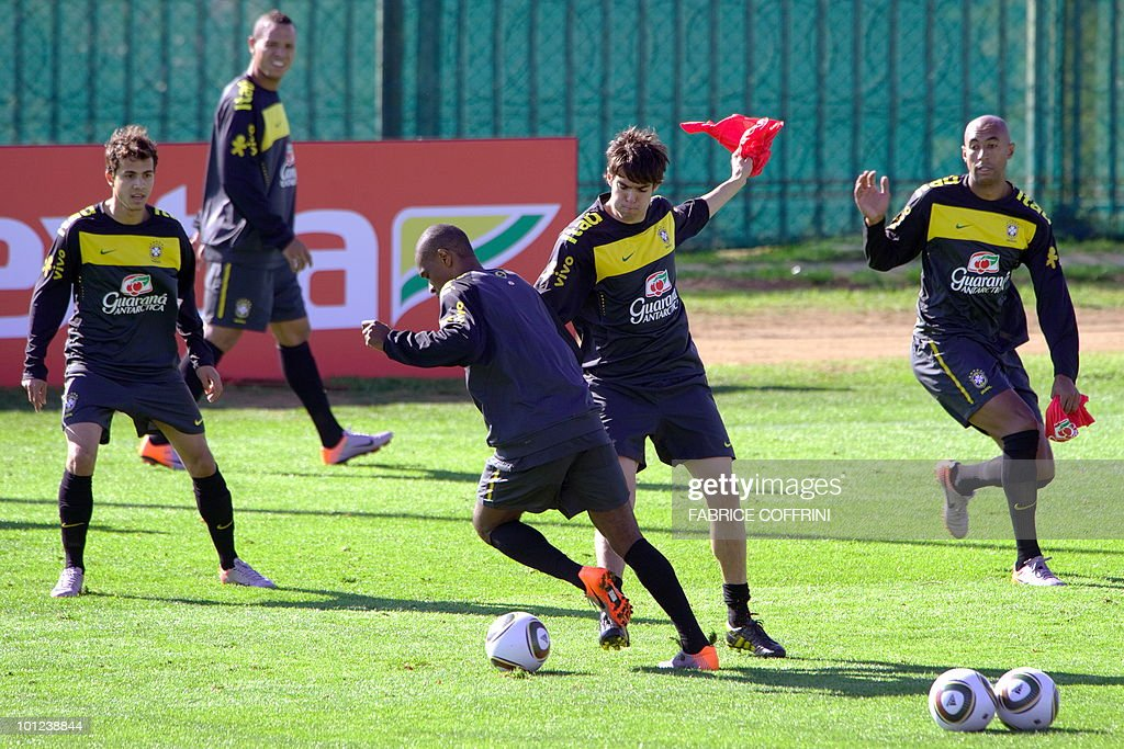 CORRECTION----Brazilian national team football players (L to R) Nilmar, Luis Fabiano, Felipe Melo, Kaka and Luisao attend a training on May 28, 2010 at Randburg High School in Johannesburg ahead of the June 11 to July 11 FIFA World Cup in South Africa.