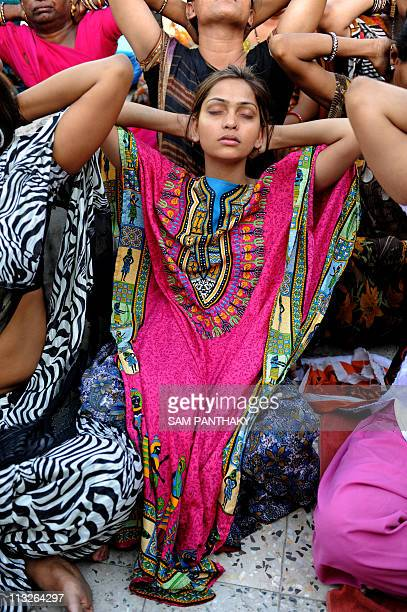 CORRECTIONIndian eunuch Nitu De a dedicated pupil of All India Kinnar Association particpates in a Yoga exercise at their centre in Ahmedabad on...