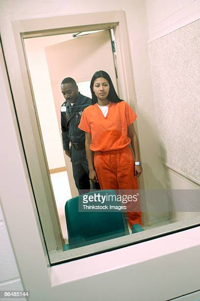 corrections officer and inmate standing in visiting room - prison guard stock pictures, royalty-free photos & images