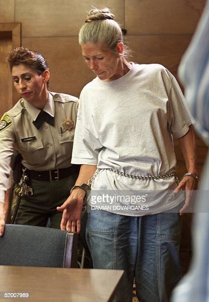 Corrections officer Sandra Fuentes assists inmate Leslie Van Houten as arrives for her parole hearing before members of the Board of Prison Terms 28...
