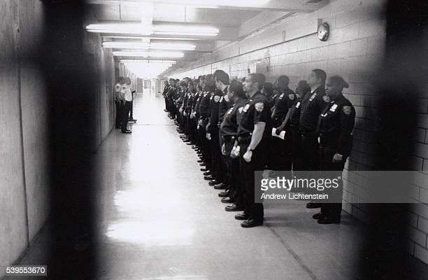 Corrections officers at New York City's jail Rikers Island ayyend roll call
