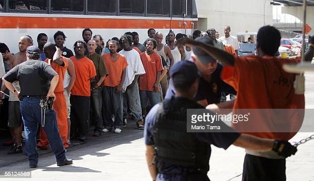 Corrections officers search a jailed inmate at a temporary prison inside a Greyhound bus terminal September 6, 2005 in New Orleans, Louisiana. About...