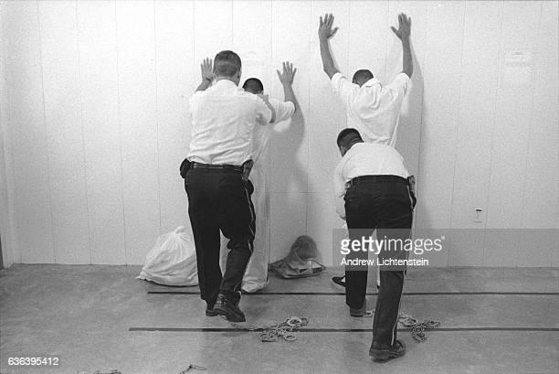 Correctios Corporation of America prison guards frisk prisoners at a private prison the Don Hutto Center run by the Corrections Corporation of...