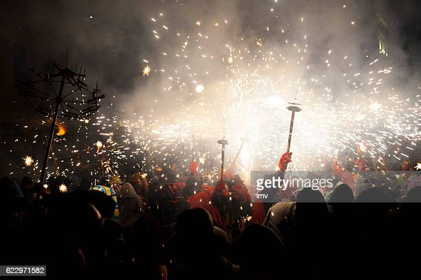 correfoc - spain traditional party in mediterranean area - demons stock photos and pictures