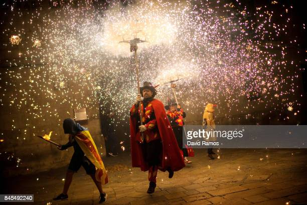 'Correfocs' perform during a Catalan proindependence demonstration on September 10 2017 in Vilafranca del Penedes Spain The Spanish Northeastern...