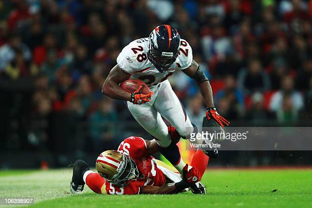 Correll Buckhalter of Denver Broncos is tackled by NaVorro Sopoaga of San Francisco 49ers as he runs with the ball during the NFL International...