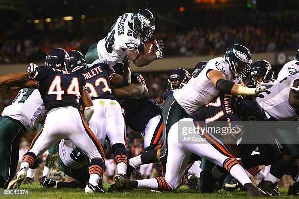 Correll Buckhalter of the Philadelphia Eagles is tackled on a third down and one at the goal line in the fourth quarter against the Chicago Bears at...