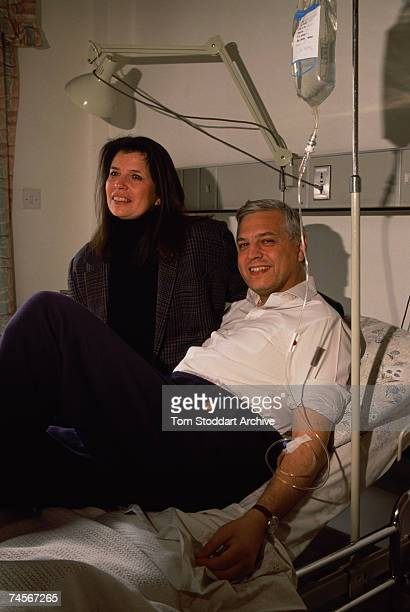 BBC correspondant John Simpson receiving treatment in a hospital in Amman Jordan 1991 He is with his girlfriend American television producer Tira...