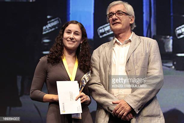 Correspondant Sara Hussein poses after receiving the young reporter's award for three dispatches on the Libyan conflict at the annual Bayeux-Calvados...