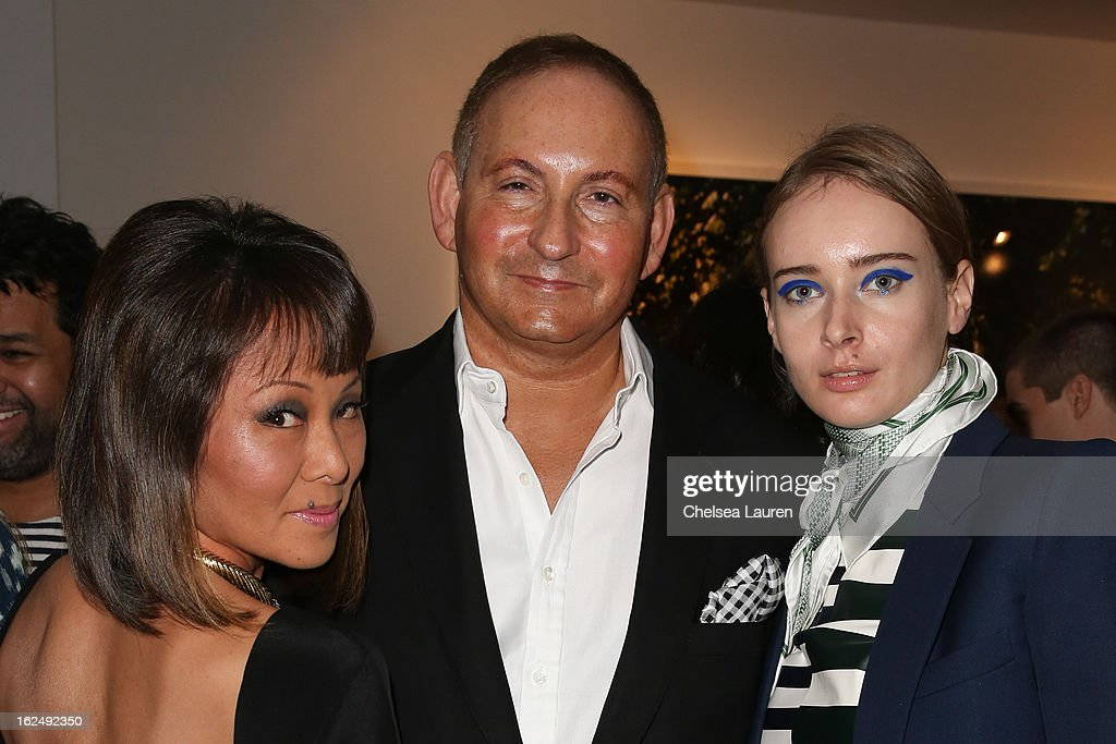 CNN correspondent Alina Cho, Estee Lauder group president John Demsey and Olga Sorokina visit the Mario Testino opening at PRISM during Academy Awards week on February 23, 2013 in Los Angeles, California.
